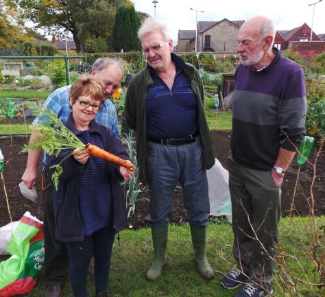 Allotment Firends admiring the carrot