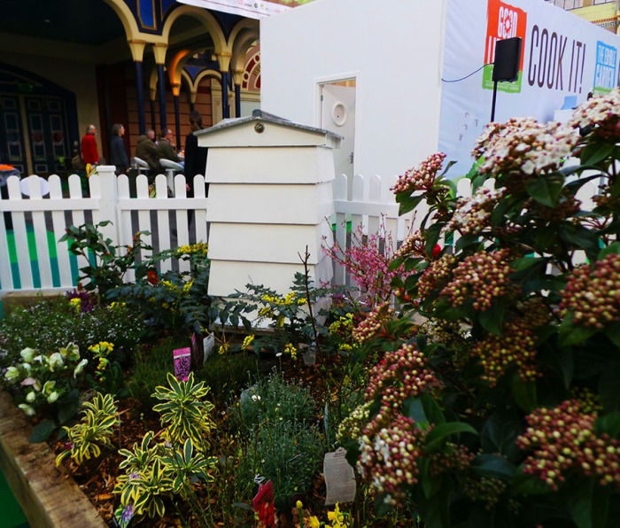The Edible Garden Show Beehive and flowers